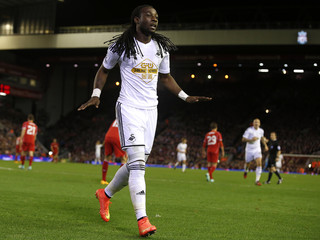 Swansea City's Marvin Emnes celebrates after scoring the opening goal during their English League Cup soccer match against Liverpool at Anfield in Liverpool,