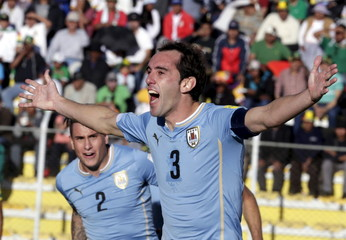 Diego Godin of Uruguay celebrates with teammates after scoring against Bolivia during their 2018 World Cup qualifying soccer match in La Paz