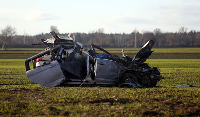 The wreckage of the car of victims of a wrong-way driver is pictured beside the highway A92 near Moosburg