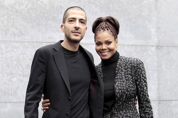 File picture shows singer Jackson and then boyfriend Al Mana arriving to attend the Giorgio Armani Autumn/Winter 2013 collection at Milan Fashion Week