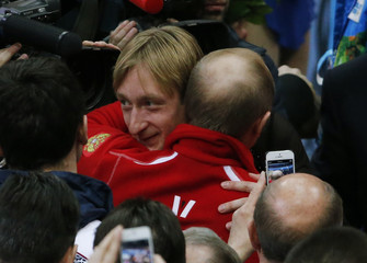 Evgeny Plyushchenko of Russia's figure skating team is greeted Russia's President Vladimir Putin at the Sochi 2014 Winter Olympics