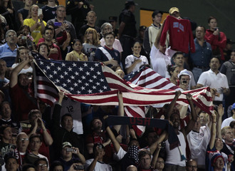 U.S. national soccer team fans hold up a U.S. flag during the 2014 World Cup qualifying soccer match against Guatemala in Guatemala City