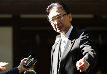 Japan's Minister-in-Charge of the Abduction Issue and head of the National Public Safety Commission Keiji Furuya speaks to the media after visiting the Yasukuni Shrine in Tokyo