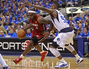 Miami Heat's LeBron James (L) drives to the net past Dallas Mavericks' DeShawn Stevenson during Game 3 of the NBA Finals basketball series in Dallas