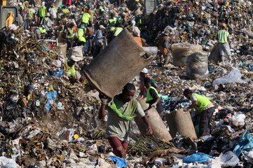 A man collects recyclable materials from Jardim Gramacho landfill in Rio de Janeiro