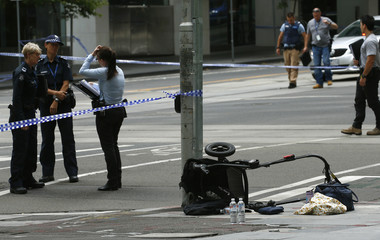 A pram is seen as police cordon off Bourke Street mall, after a car hit pedestrians in central Melbourne