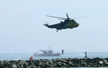 A CH 124 Sea King performs a search and rescue demonstration during the Canadian International Air Show in Toronto
