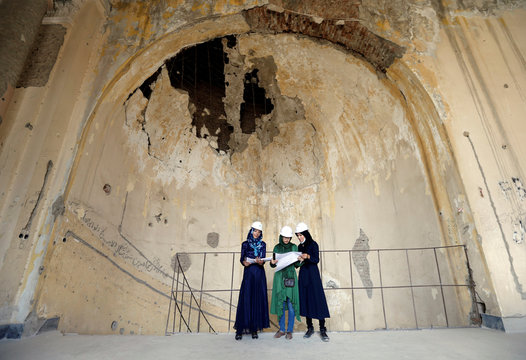 Afghan female engineers work on a map of the ruined Darul Aman palace in Kabul