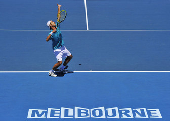 Gasquet of France serves to Seppi of Italy during their men's singles match at the Australian Open tennis tournament in Melbourne