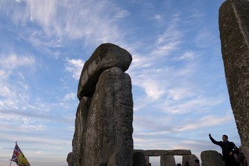 A reveller celebrates the longest day of the year at Stonehenge on Salisbury Plain in southern England