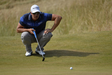 Henrik Stenson of Sweden lines up his putt on the third green during the third round of the British Open golf championship at Muirfield in Scotland