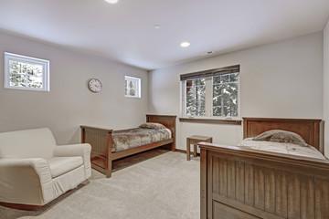 Spacious Kids bedroom with light beige walls