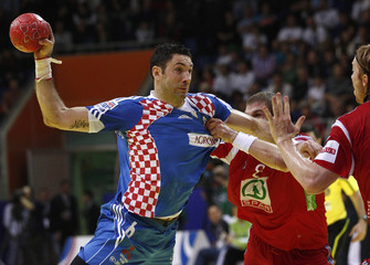 Croatia's Lackovic tries to score past Norway's Myrhol and Lund during their Men's European Handball Championship Group D match in Vrsac
