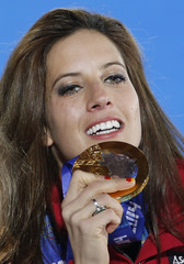 Gold medallist Austria's Dujmovits celebrates during the victory ceremony for the women's parallel slalom snowboard event at the 2014 Sochi Winter Olympics in Sochi