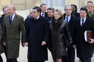 Members of the French government walk in the Elysee courtyard to attend the first cabinet meeting of the year in Paris