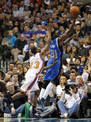 Dallas Mavericks' Terry drives past New York Knicks' Douglas during their NBA basketball game in Dallas