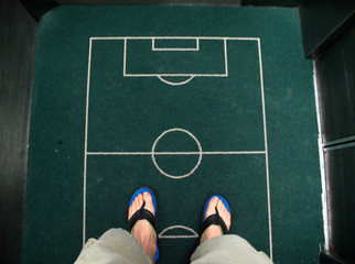 A soccer pitch is sewn on the floor mat in a hotel elevator in Fortaleza
