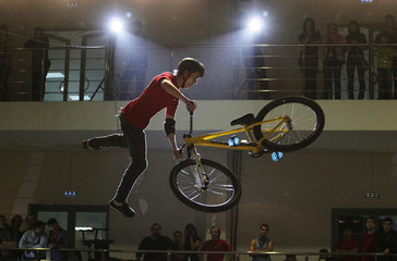 A rider performs during the Night Ride event at the Sportex indoor extreme sports centre in the Siberian city of Krasnoyarsk