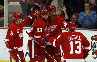 Detroit Red Wings' Bertuzzi celebrates with his teammates after he scored against the Winnipeg Jets during the first period of their NHL hockey game in Detroit