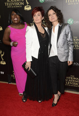 Actress Underwood, entertainment personality Sharon Osbourne and actress Gilbert arrive at the 41st Annual Daytime Emmy Awards in Beverly Hills