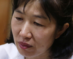 Misa Morimoto, the 50-year-old identical younger twin of Miho Yamamoto, cries as she speaks during an interview with Reuters in Otsuki city, Yamanashi prefecture