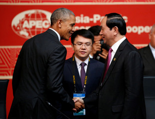 Obama greets Vietnam's President Quang at the APEC Summit  in Lima, Peru