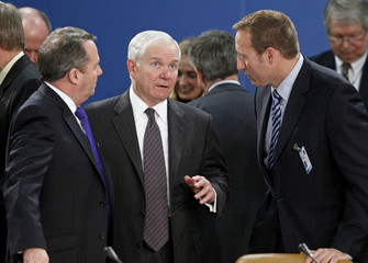 Fox, Gates and MacKay  attend a NATO defence ministers meeting at the Alliance headquarters in Brussels