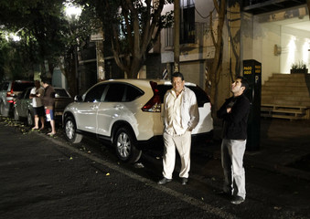 People wait outside their houses after an earthquake struck in Mexico City