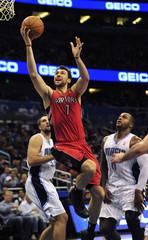 Toronto Raptors forward Anrea Bargnani splits Orlando Magic defense forwards Ryan Anderson and Glen Davis in Orlando