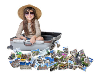 Long haired little girl with straw hat is sitting in a open suitcase. Photos of the sights of Amsterdam (Netherlands) flies around the suitcase. All is on the white background. Horizontally.