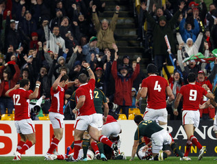 Wales players react as Toby Faletau scores a try during their Rugby World Cup Pool D match against South Africa Springboks at Wellington Regional Stadium in Wellington