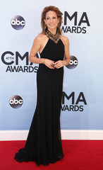 Sheryl Crow poses on arrival at the 47th Country Music Association Awards in Nashville