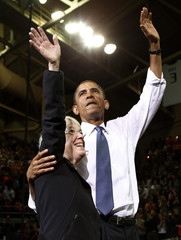 U.S. President Barack Obama waves at a campaign rally for Democratic Senator Patty Murray in Seattle