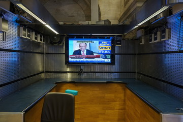 A television screen sits in an empty space on the floor of the New York Stock Exchange shortly after an announcement by the Federal Reserve Bank in New York