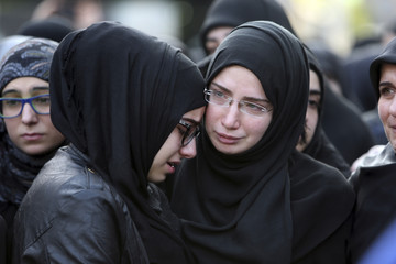 Sister of Ali Khadra, man that was killed by a car bomb explosion that occurred on Thursday, reacts during his funeral in Beirut's southern suburbs