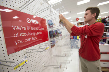 An employee stocks shelves at Target's store in Guelph, Ontario