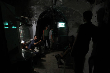 Free Syrian Army fighters rest in their safe house in the old city of Aleppo