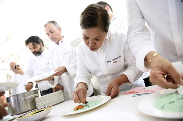 "Cristeta Comerford, Chef to U.S. President Barack Obama, cooks an Italian Risotto during the annual meeting of the ""Chef des Chefs Club"" (CCC) in Livorno Ferraris"