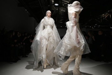 Models present creations by designer Gareth Pugh as part of his Fall/Winter 2014-2015 women's ready-to-wear collection show during Paris Fashion Week