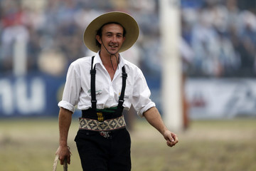 A gaucho smiles while participating in the annual celebration of Criolla Week in Montevideo