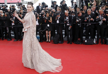 Actress Fan Bing Bing arrives on the red carpet for the screening of the film De rouille et d'os at the 65th Cannes Film Festival