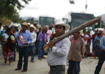 Residents of the mountain region of Guerrero take part in a road blockade on the outskirts of Chilpancingo