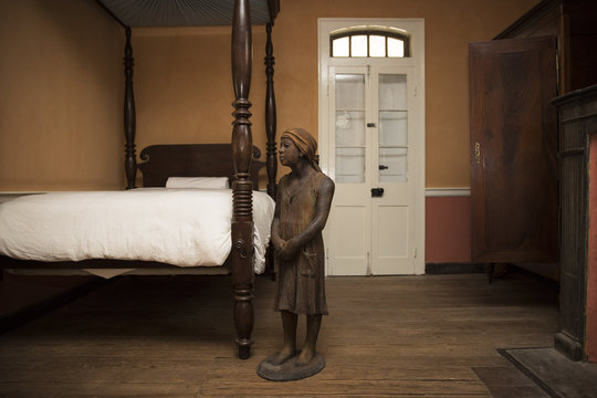 A terra-cotta statue of a child slave inside the main house at the Whitney Plantation in Wallace Louisiana