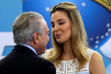 First lady Marcela Temer reacts near Brazil's President Michel Temer during a launch ceremony of the Happy Child Program  at the Planalto Palace in Brasilia