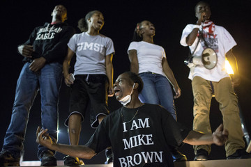 Protesters gather near the police department in Ferguson