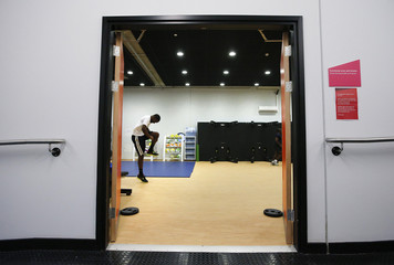 Brathwaite, member of Barbados athletics team, works out at athletes village at Olympic Park in London