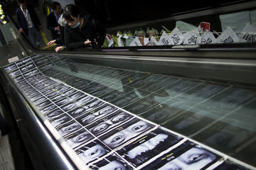 An artwork showing photograph and messages by local artist is seen on an escalator,in the part of Hong Kong's financial central district occupying by pro-democracy protesters