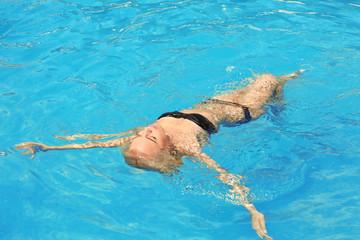 Beautiful girl in swimming pool