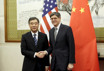 U.S. Secretary of the Treasury Jack Lew shakes hands with China's Vice Premier Wang Yang in Beijing
