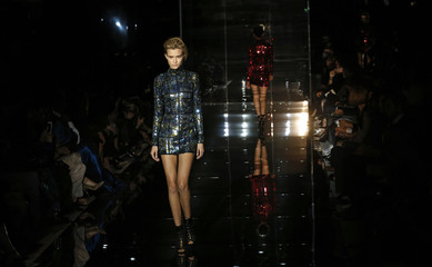 Models present creations from the Tom Ford Spring/Summer 2014 collection during London Fashion Week
